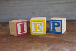IEP Meeting in wood blocks